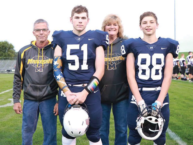 Tanner and family at parents night football game.